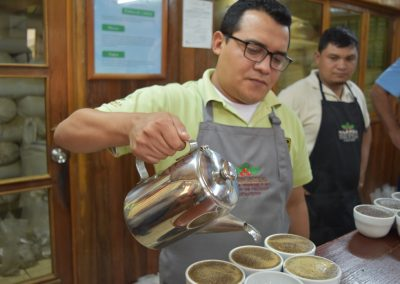 man pouring coffee into small bowls